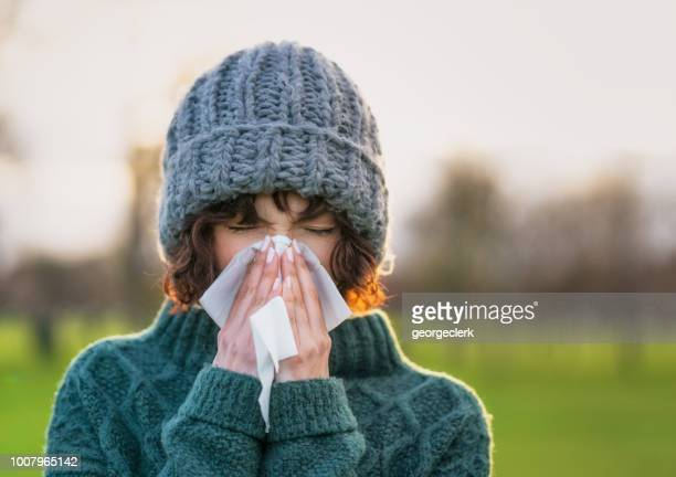 coping with a winter cold - handkerchief stock pictures, royalty-free photos & images