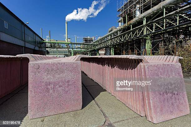 Copper anode plates sit in an outdoor storage yard at the Aurubis AG metals plant in Hamburg Germany on Thursday April 21 2016 China has accumulated...