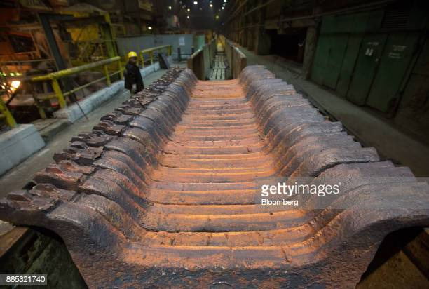 Copper anode sheets hang as they cool at the MMC Norilsk Nickel PJSC copper refinery in Norilsk Russia on Thursday Oct 19 2017 Norilsk Nickel which...