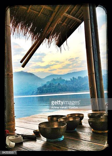 copper bowls on porch - thai massage stock photos and pictures