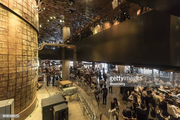 A copper cask left stands inside the Starbucks Corp Reserve Roastery store in Shanghai China on Friday May 11 2018 Starbucksis laying out an...