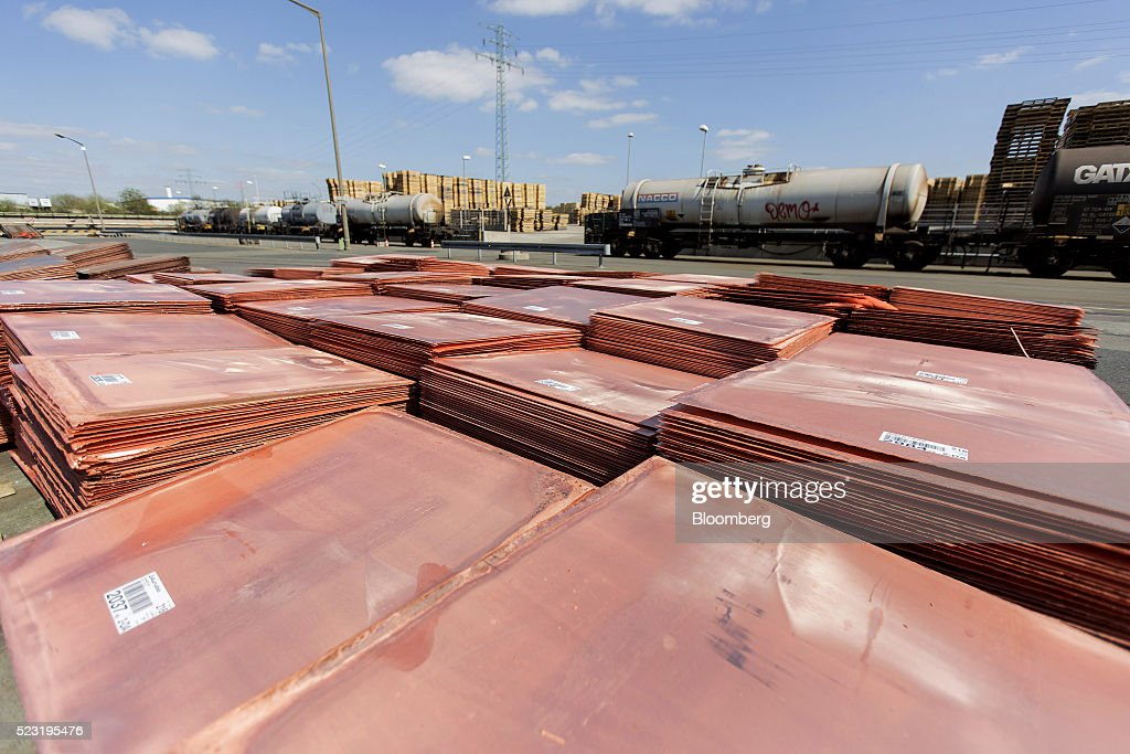 Copper cathode plates sit in an outdoor storage yard at the Aurubis