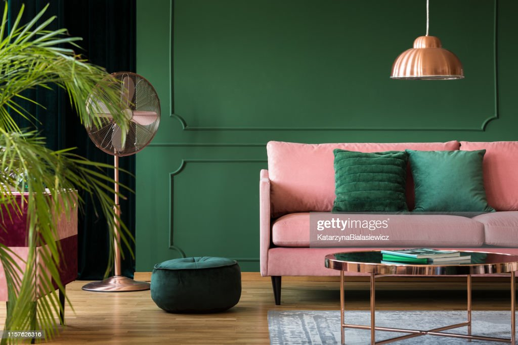 Copper lamp and table in a green living room interior. Real photo : Stock Photo