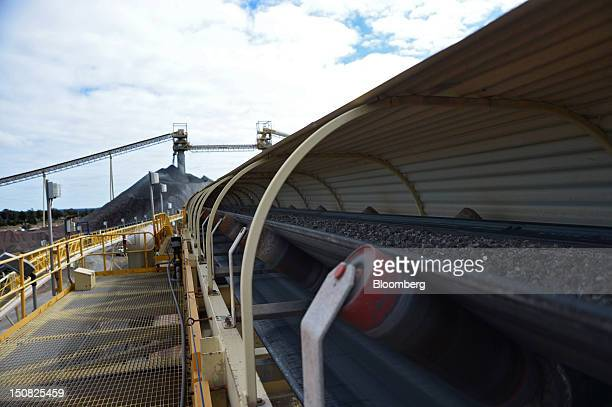 Copper ore moves along a conveyor belt from a stockpile to the grinding facility at the processing plant of Rio Tinto Group's Northparkes copper and...