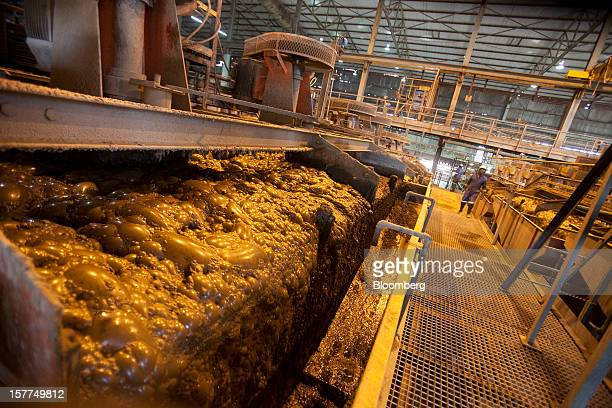 Copper sulphide slurry pours from a machine in a processing facility at Katanga Mining Ltd's copper and cobalt mine in Kolwezi Katanga province...