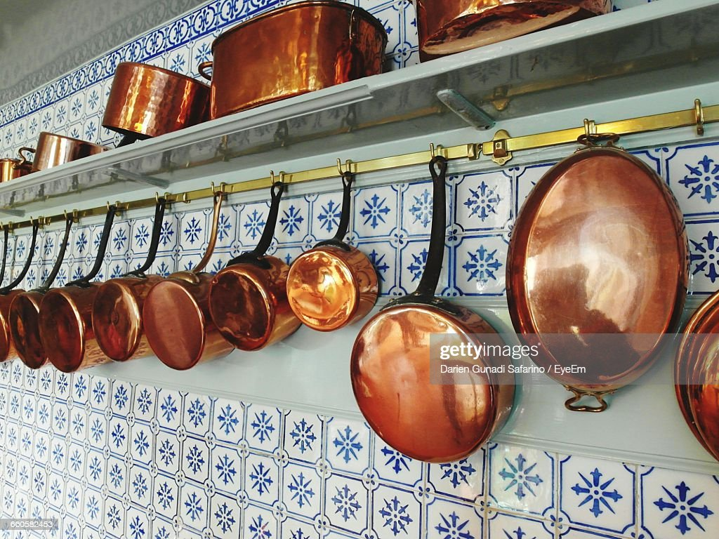 Copper Utensils On Wall : Stock Photo