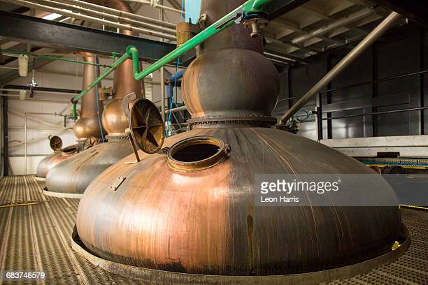 Copper whisky stills in whisky distillery