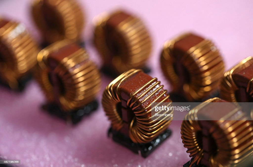 Copper wired components sit waiting to be put onto printed circuit boards at Texcel Technology Plc's factory in Dartford, U.K., on Tuesday, July, 28, 2015. U.K. economic growth accelerated in the second quarter as business services and finance strengthened and North Sea output surged. Photographer: Chris Ratcliffe/Bloomberg via Getty Images
