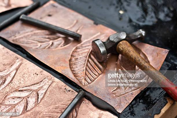 Coppersmith tools and copper sheets with leaves