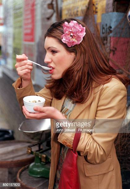 Copresenter of the 'Big Breakfast' Kelly Brook enjoys a quick snack outside Elstree studios in London where the onscreen wedding reception of...