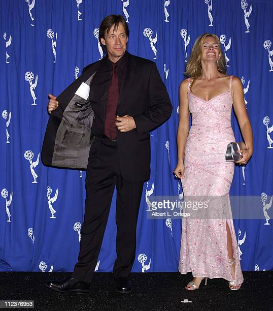 Copresenters Kevin Sorbo and Natasha Henstridge during 2002 Creative Arts Emmy Awards Press Room at Shrine Auditorium in Los Angeles California...