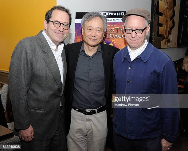 CoPresident and CoFounder of Sony Pictures Classics Michael Barker director Ang Lee and screenwriter James Schamus pose together for a photo at the...