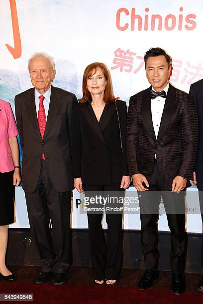 CoPresident of the Festival and President of Pathe Jerome Seydoux Isabelle Huppert and Donnie Yen attend the 6th Chinese Film Festival Photocall at...