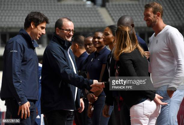 Copresident of the Paris bid for the 2024 Olympics Tony Estanguet and Patrick Baumann president of the IOC Evaluation Commission shake hands as...