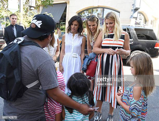 Copresidents of Baby2Baby Norah Weinstein and Kelly Sawyer Patricof and actress Busy Philipps attend the Baby2Baby Back To School Event At The Grove...