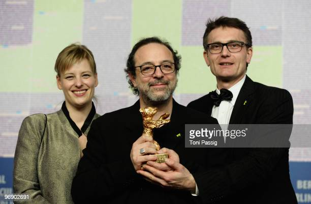 Co-producer Bettina Brokemper, director Semih Kaplanoglu and co-producer Johannes Rexin pose with the Golden Bear Award for Best Film at the 'Award...