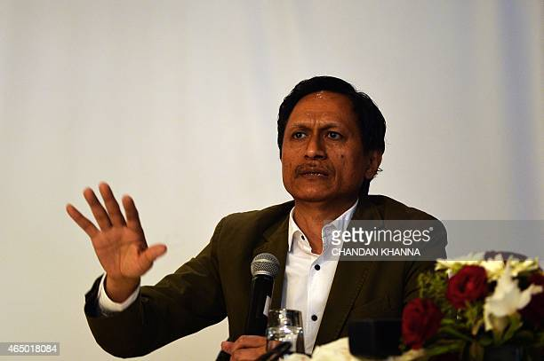 Coproducer of the documentary 'India's Daughter' Indian TV journalist Dibang gestures during a press conference in New Delhi on March 3 2015 One of...