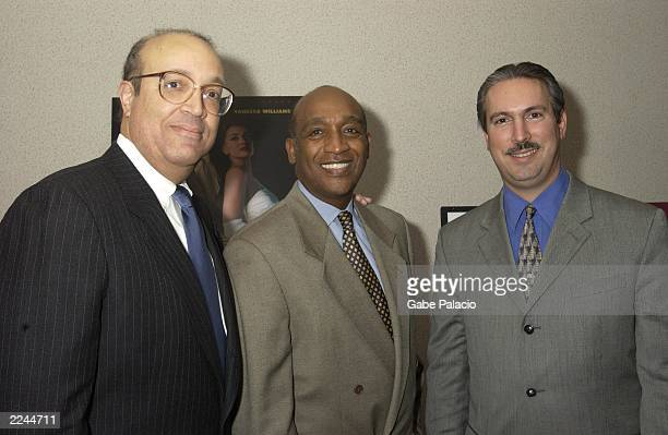 CoProducers Adam Clayton Powell IV and Adam Clayton Powell III surround Dennis Johnson Executive Producer at the premiere of Showtime's Keep the...