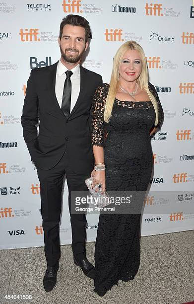 CoProducers Andrea Iervolino and Monika Bacardi attend 'The Humbling' premiere during the 2014 Toronto International Film Festival at The Elgin on...