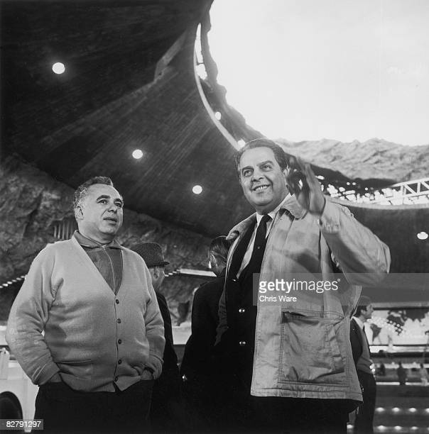 Coproducers Harry Saltzman and Albert 'Cubby' Broccoli on the set of the James Bond film 'You Only Live Twice' at Pinewood Studios 28th October 1966...