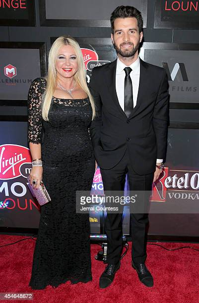 CoProducers Monika Bacardi and Andrea Iervolino attend 'The Humbling' at the Virgin Mobile Movie Lounge on September 4 2014 in Toronto Canada