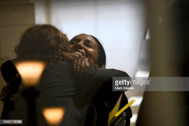 Coprosecutor Kristen Gibbons Feden embraces a friend before Bill Cosby was sentenced to 310 years in the assault retrial at the Montgomery County...
