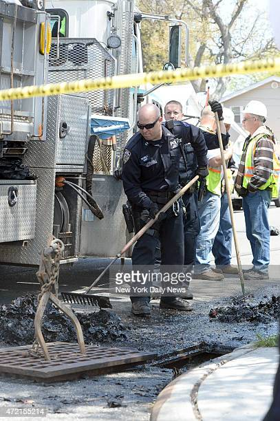 Cops search a sewer drain looking for the gun allegedly used by Demetrius Blackwell to shoot an undercover cop Brian Moore in the head