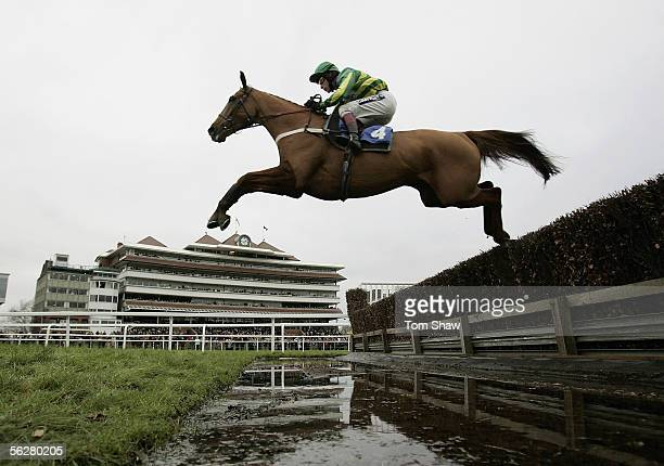Copsale Lad ridden by Mick Fitzgerald jumps the water jump on his way to winning the Dubai Duty Free Fulke Walwyn Novices Steeple Chase during the...