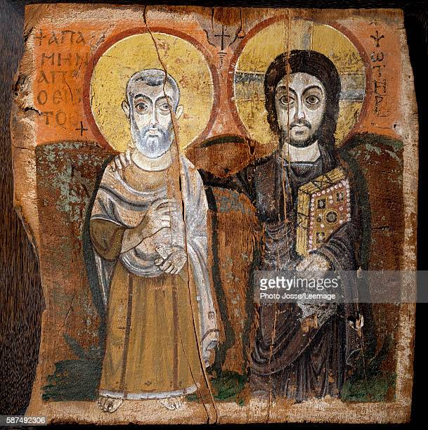 Christ and Abbot Mena Saint Menas Egyptian martyr of the 3rd century Fragment of a painting on wood 6th or 7th century 57x 57cm From the site of...