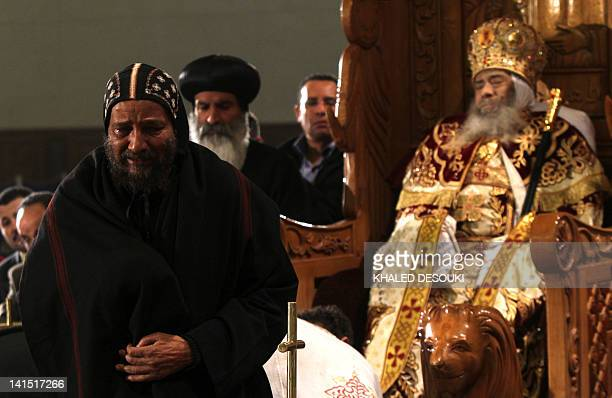 A Coptic Christian mourns the death of Pope Shenuda III the spiritual leader of the Middle East's largest Christian minority after paying his...