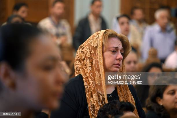 A Coptic Christian woman mourns victims killed in an attack a day earlier during an early morning ceremony at the Prince Tadros church in Egypt's...