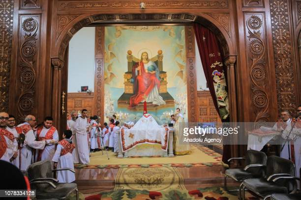 Coptic Christians take part in an Orthodox Christmas mass at the Saint Mark's Coptic Cathedral in Cairo Egypt on January 7 2019