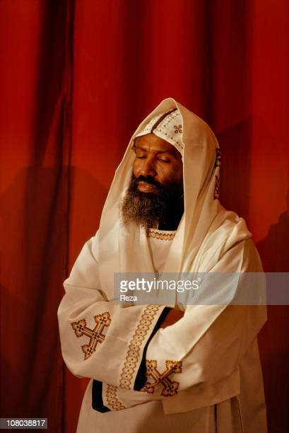 Coptic monk wearing white symbol colour of the purity of the angels is in deep contemplation during the Coptic Christmas ceremony celebrated in the...