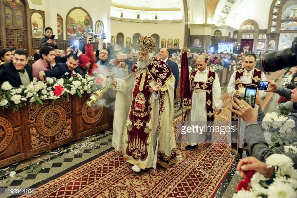 Coptic Orthodox Pope Tawadros II holds the Christmas Eve mass at the Nativity of Christ Cathedral in Egypt's administrative capital, 45 kms east of...