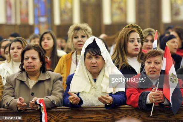 Coptic Orthodox worshippers attend Christmas Eve mass at the Nativity of Christ Cathedral in Egypt's administrative capital, 45 kms east of Cairo, on...