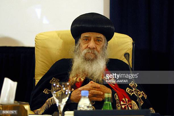 Coptic Pope Shenouda attends a conference on MuslimChristian Dialogue in Doha 27 May 2004 The conference opened in Qatar with an official call to...