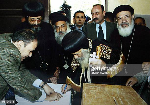 Coptic Pope Shenouda III Patriarch of Alexandria and the See of St Mark casts his ballot 09 November 2005 during parliamentary elections in Cairo...