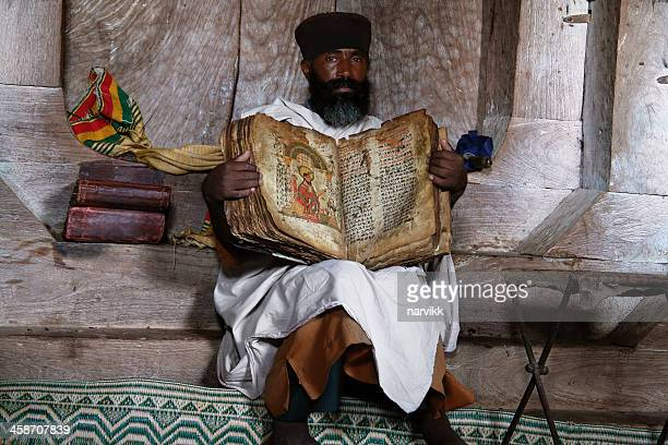 coptic priest with old bible - orthodox church stock pictures, royalty-free photos & images