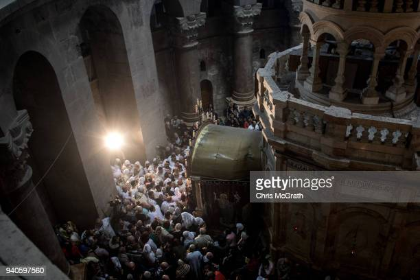 Coptic Priests take part in rituals outside the Tomb of Christ to celebrate Easter Sunday at the Church of the Holy Sepulchre in the Old City on...