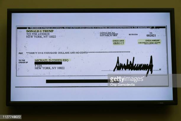 A copy of a check paid to Michael Cohen by President Trump is displayed as Michael Cohen former attorney and fixer for President Donald Trump...