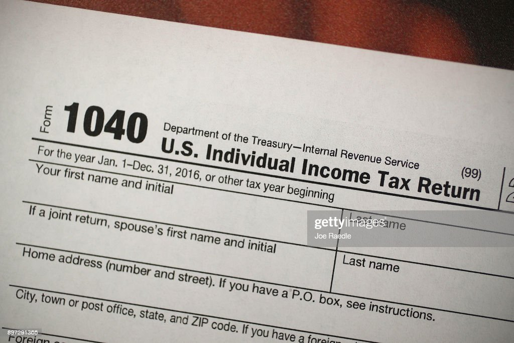 Tax Consultants Prepare For New Tax Guidelines : News Photo