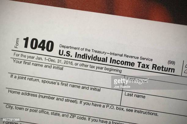 A copy of a IRS 1040 tax form is seen at an HR Block office on the day President Donald Trump signed the Republican tax cut bill in Washington DC on...