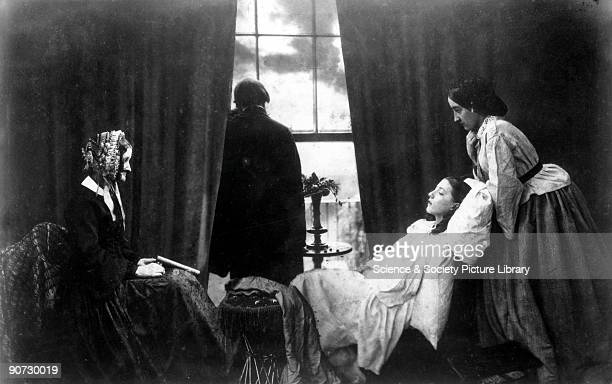 Copy of an albumen silver print by Henry Peach Robinson , showing a young girl on her deathbed surrounded by her family. Robinson is noted for his...