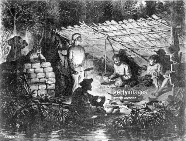 Copy of an engraving showing African Americans hiding in the swamps of Louisiana with a campfire and under a lean-to, 1873. They hid as a result of...