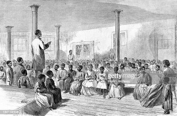 Copy of an illustration showing teachers and students in a classroom of the American Missionary Association's Zion school for colored children which...