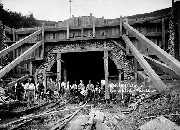 Copy of an original platinum print showing navvies posing in front of timbering shoring up the north end of the railway tunnel during its...