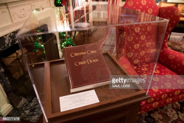 A copy of Charles Dickens' A Christmas Carol belonging to former US President Franklin D Roosevelt is seen during a preview of holiday decorations in...