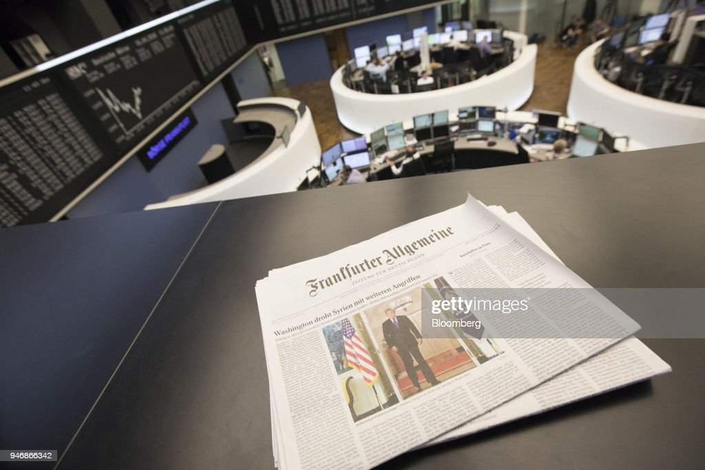 A copy of Frankfurter Allgemeine broadsheet newspaper features a photo of U.S. President Donald Trump, on a balcony overlooking the trading floor inside the Frankfurt Stock Exchange, operated by Deutsche Boerse AG, in Frankfurt, Germany, on Monday, April 16, 2018. Bonds declined, stocks were steady and oil fell on anticipation that the fallout from missile strikes in Syria will be limited. Photographer: Alex Kraus/Bloomberg via Getty Images