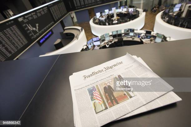 A copy of Frankfurter Allgemeine broadsheet newspaper features a photo of US President Donald Trump on a balcony overlooking the trading floor inside...