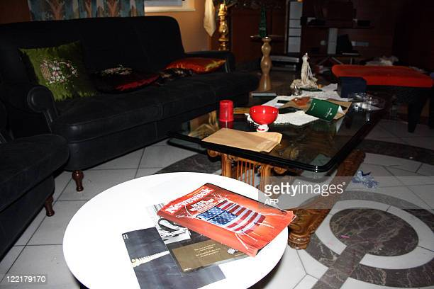 A copy of Newsweek magazine sits on a table in the living room of Aisha Kadhafi daughter of Libya's leader Moamer Kadhafi at her house in Tripoli on...